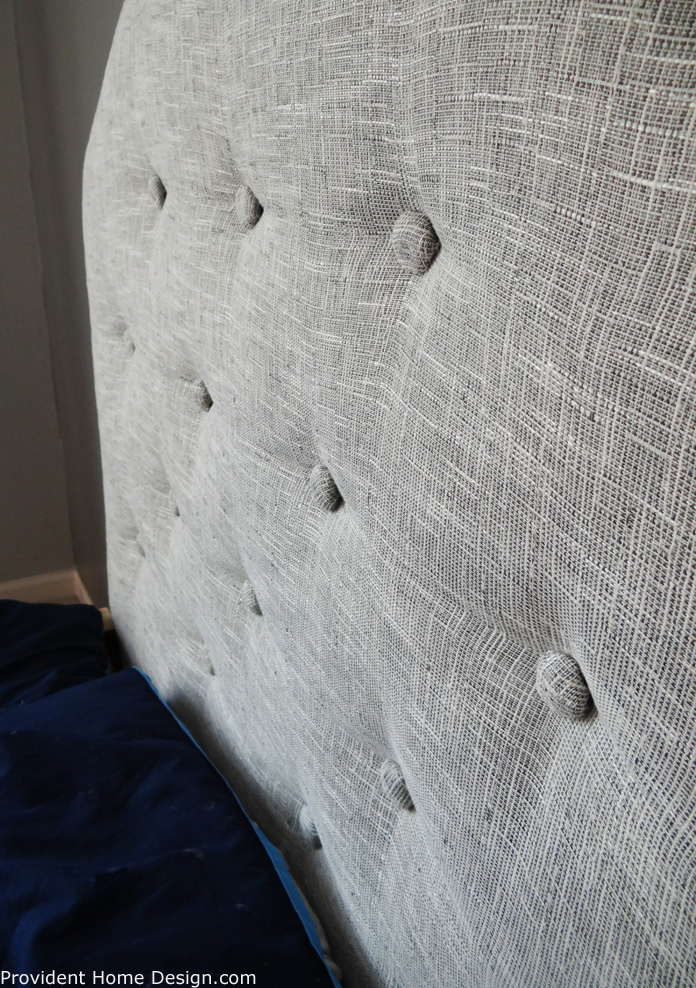 gray upholstered headboard