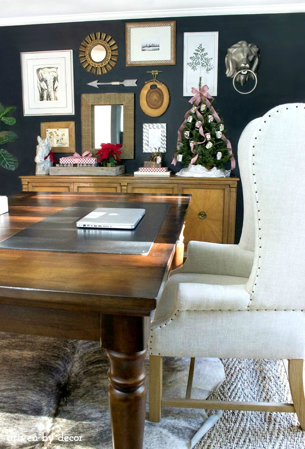 Driven by Decor Our-home-office-decorated-for-the-holidays-gallery-wall-wrapped-gifts-advent-tree-World-Market-table-cowhide-rug-jute-rug-and-wingback-chair