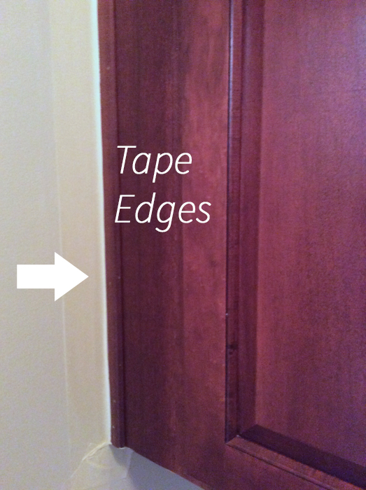 Tape the sides of the cabinets